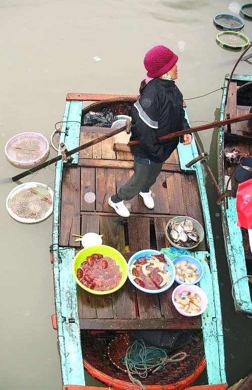 Halong Bay floating market hawker.