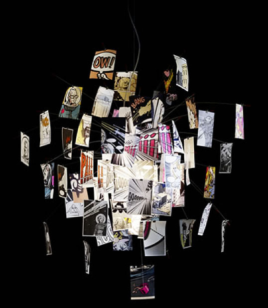 Pendant light fixture made with sheets of paper printed with comic book characters