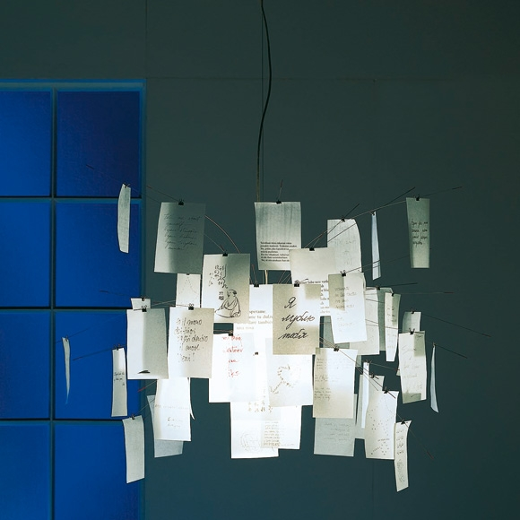 Pendant light fixture of paper printed with poems and proverbs in different languages