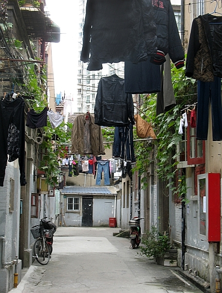 Hutong residents hang their laundry above the alley