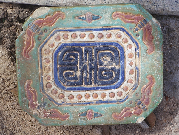 Ceramic drain cover on the Church grounds
