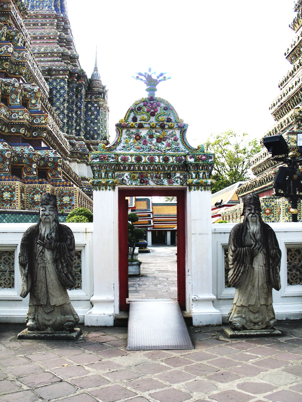 Stone guardians by Wat Pho temple gate