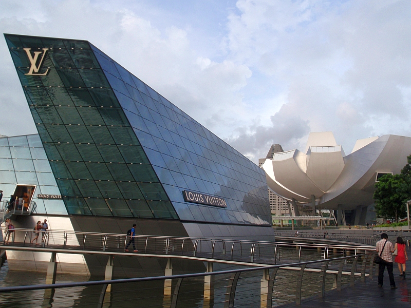 Louis Vuitton floating pavilion with lotus-shaped ArtScience Museum in background