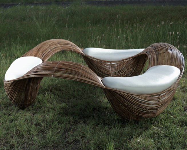 Three seats linked together by a wave-like design