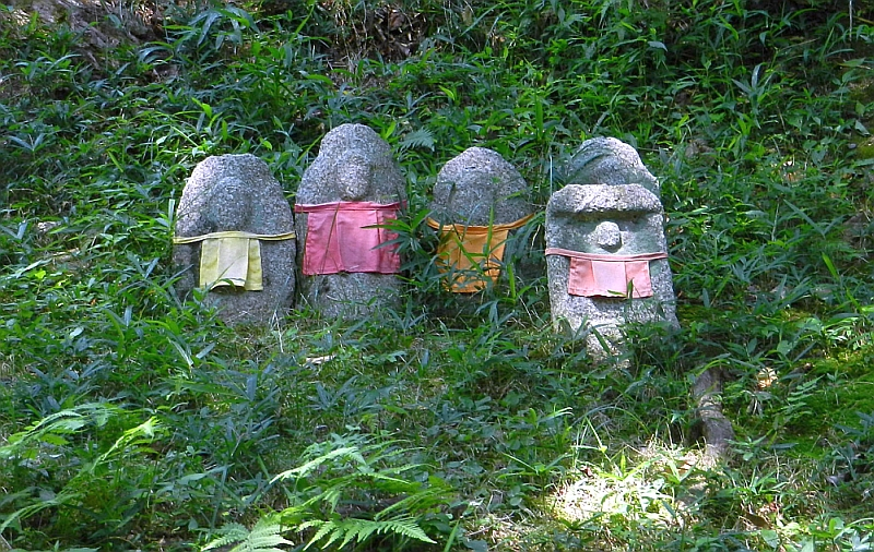 Jizo stone statues with aprons at Kiyomizu temple