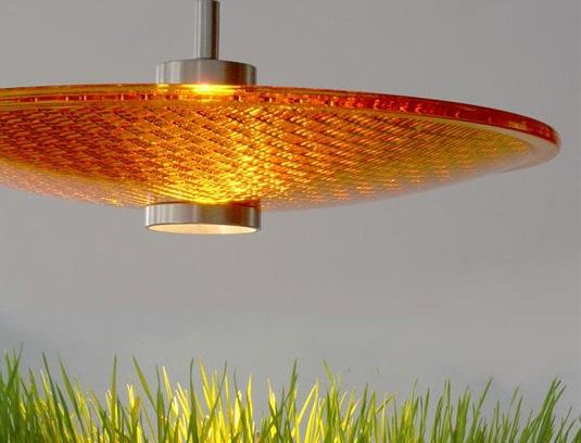 Pendant light fixture from yellow traffic light glass