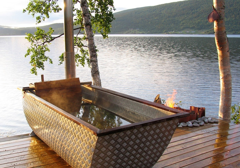 An outdoor wood-fired bathtub