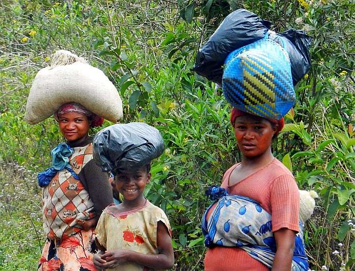 Locals carrying sacks of goods on their heads