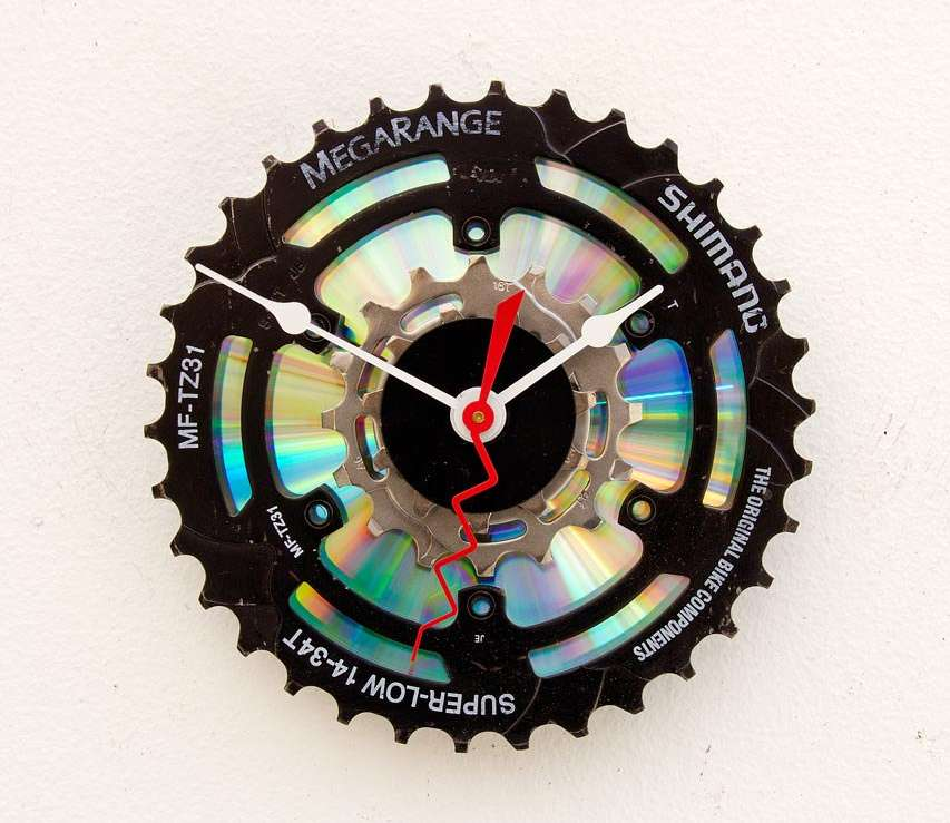 Clock of recycled bike crank gear and CD disk