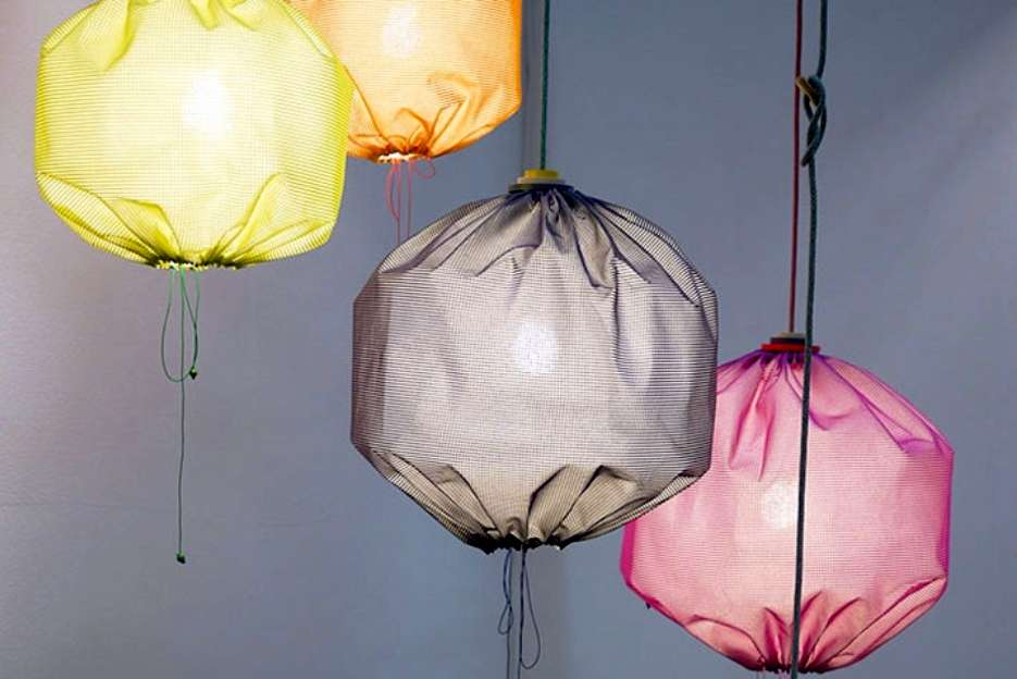 A lamp shade made from recycled sun screen material