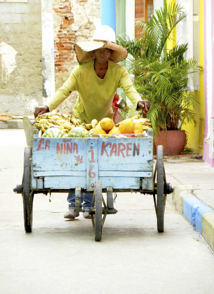 Fruit vendor with a traditional pushcart in Cartagena