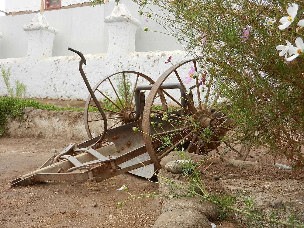 Abandoned cart outside a church.