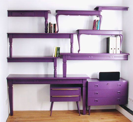 Desk with wall shelving made from salvaged coffee tables
