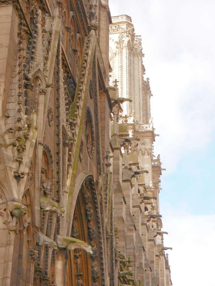 Neat rows of gargoyles line the façade of the Notre Dame de Paris.