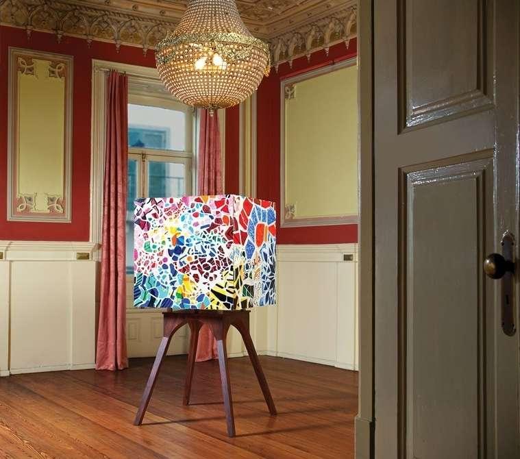 Colorful bar cabinet reminiscent of Antoni Gaudi's tile mosaics