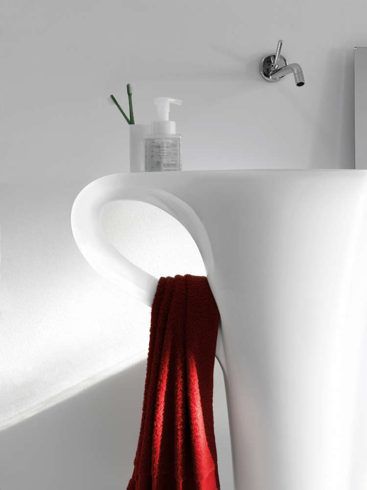 A coffee cup shaped pedestal sink