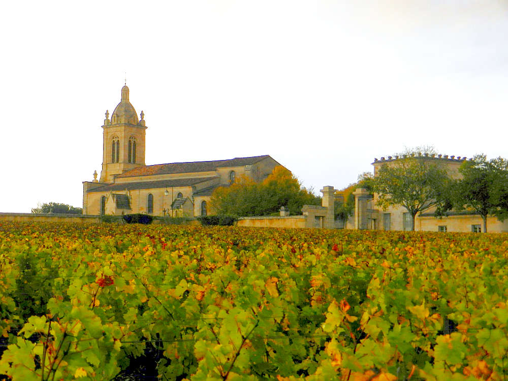 Picturesque winery seen against the fall foliage of grape vines in Pauillac.