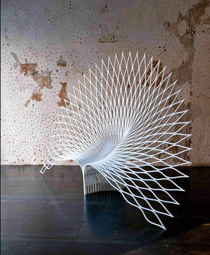 A chair shaped like the fanned out tail of a peacock