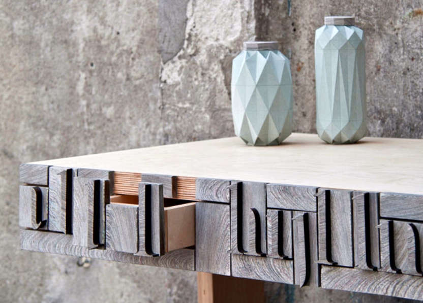 Details on NewspaperWood console drawer pull.