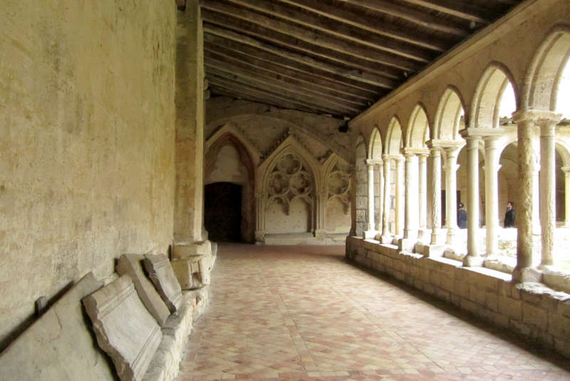 Cloister of the Collegiate Church of Saint-Emilion. The local ocher limestone gives the buildings a warm glow.