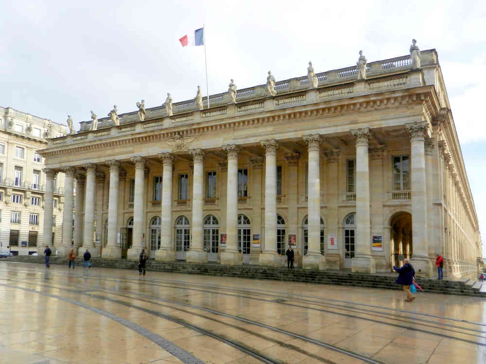 Reflections of the Grand Théâtre de Bordeaux on limestone pavers after some early morning rain.