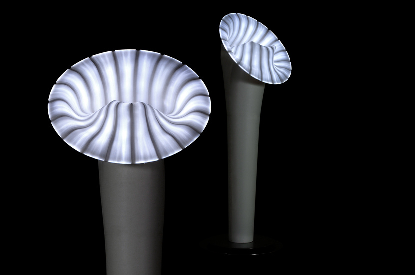 A trumpet shaped floor lamp made of silicon
