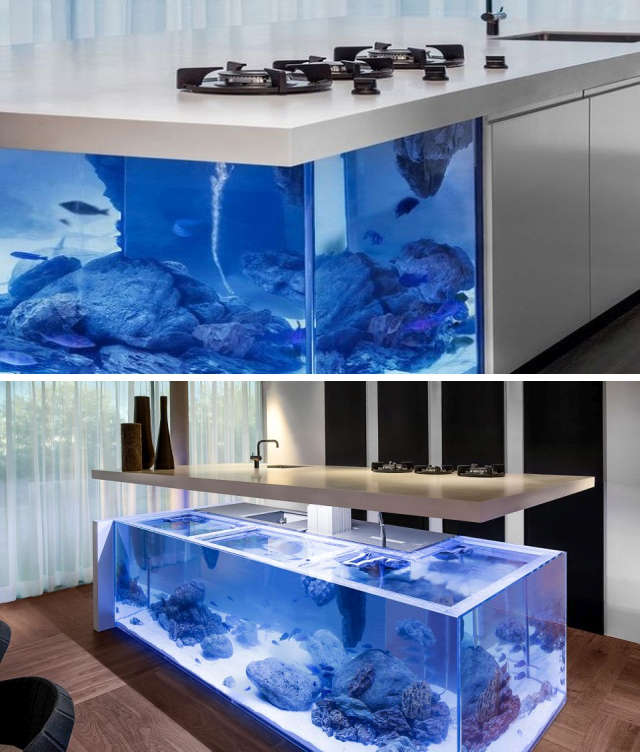 A kitchen island with a built-in aquarium
