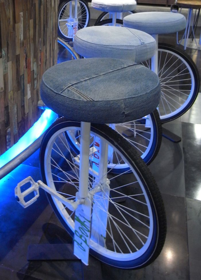 Bicycle wheels and frames repurposed as barstools