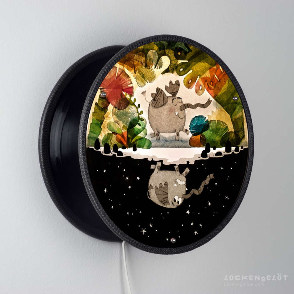 Wall light fixture made from upcycled vinyl records
