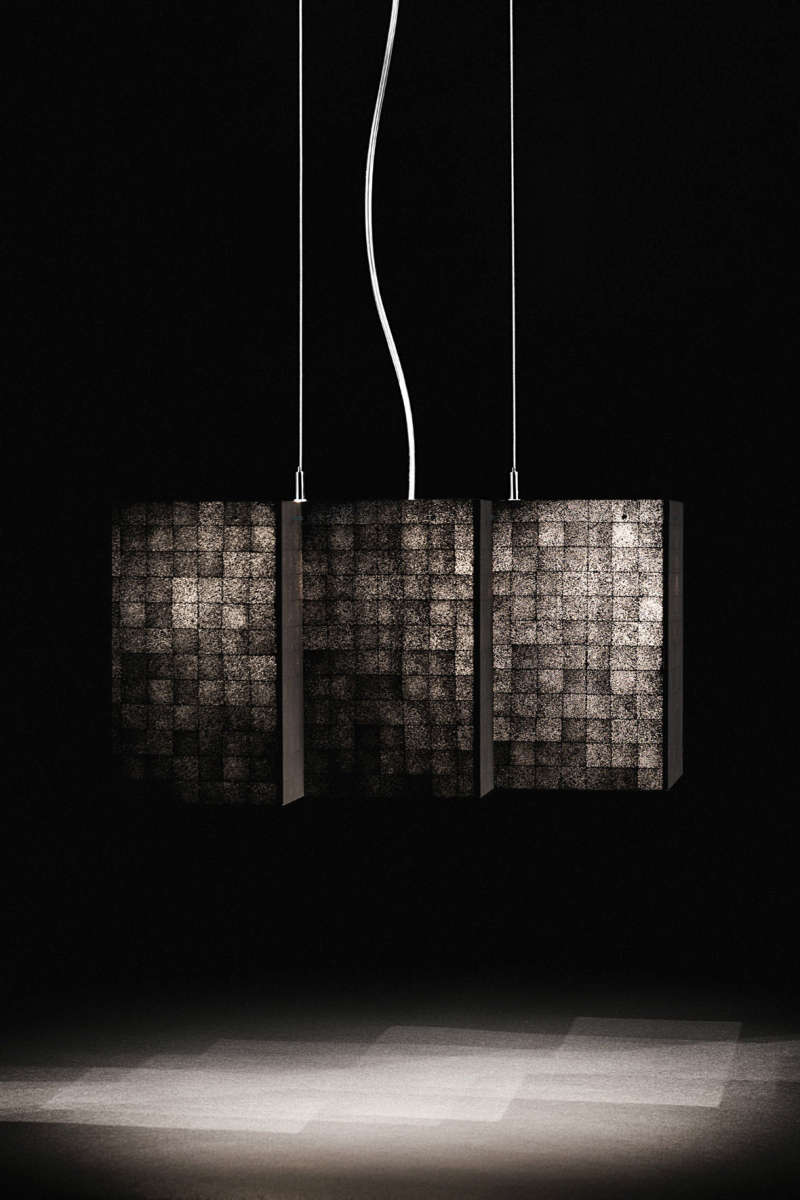 Light fixture with a translucent shade made from a highly renewable resource – rattan.
