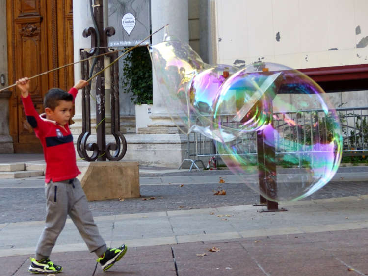 Boy playing with super soap bubbles
