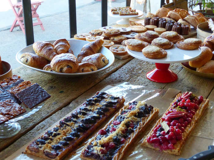 Baked goods on a long trestle table at Jouvaud. bakery