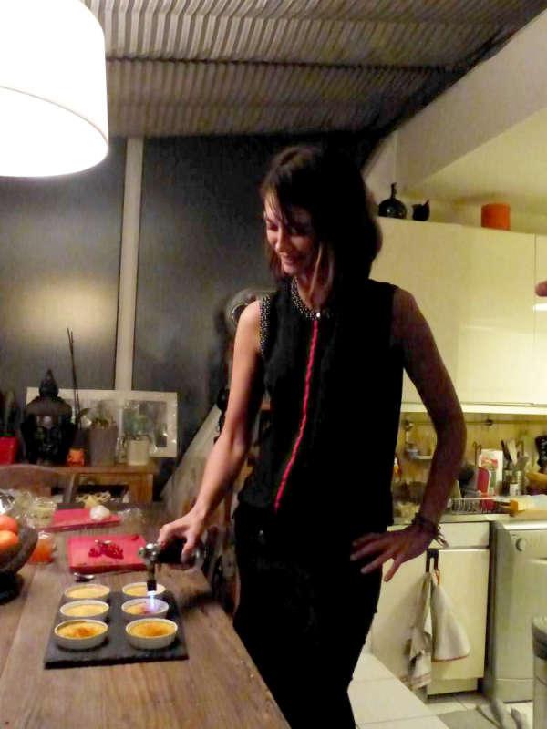 Our dinner hostess applying a blow torch to her salmon crème brûlée