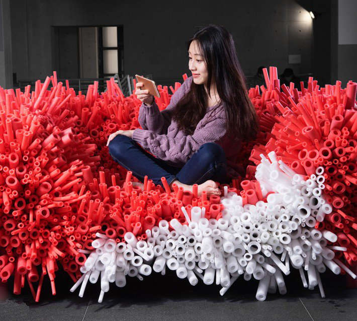 A sofa that looks like a red and white sea anemone