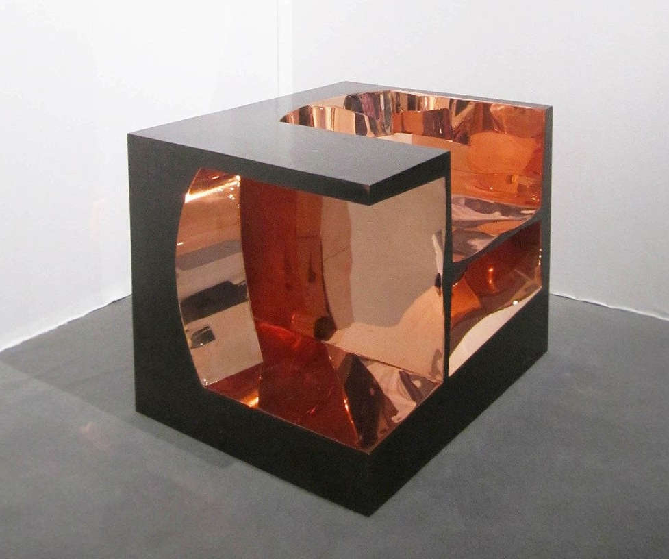 A copper cube shaped chair