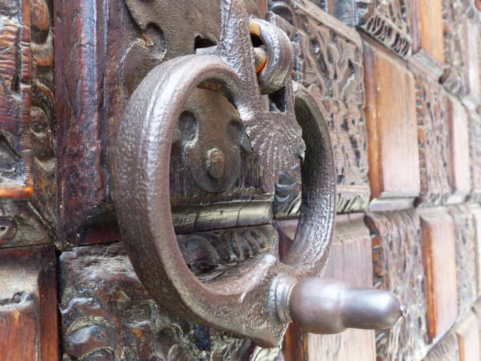 A elaborate gate and knocker.