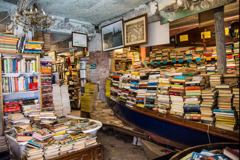Bookstore in Venice storing books in a gondola