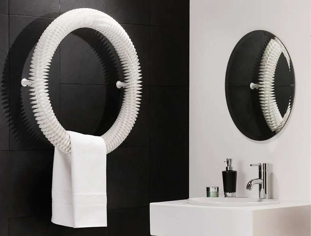Circular wall heater and towel holder