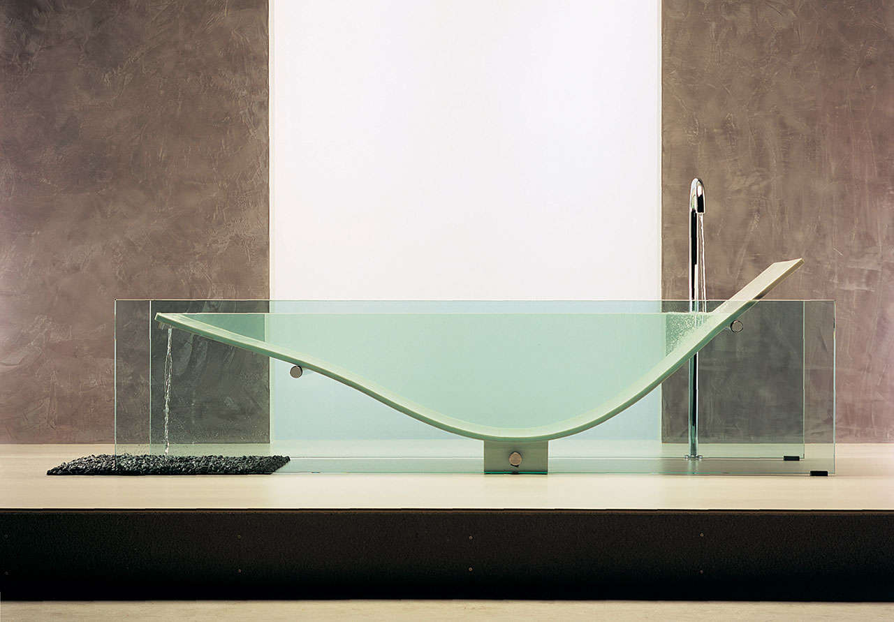 A bathtub made with glass and Corian