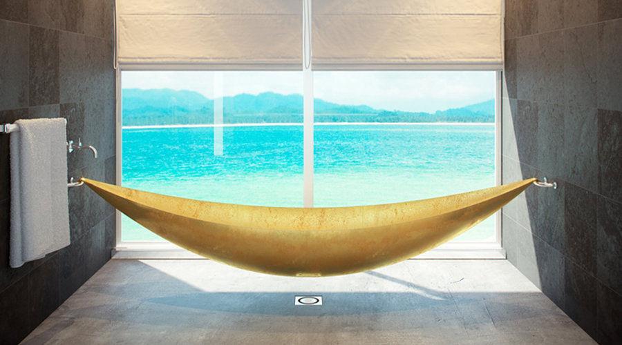 A hammock bathtub covered in 24 karat gold leaf