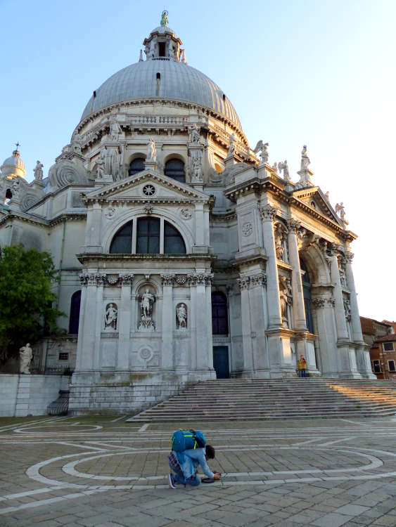 Photographer in front of Basilica di Santa Maria della Salute.