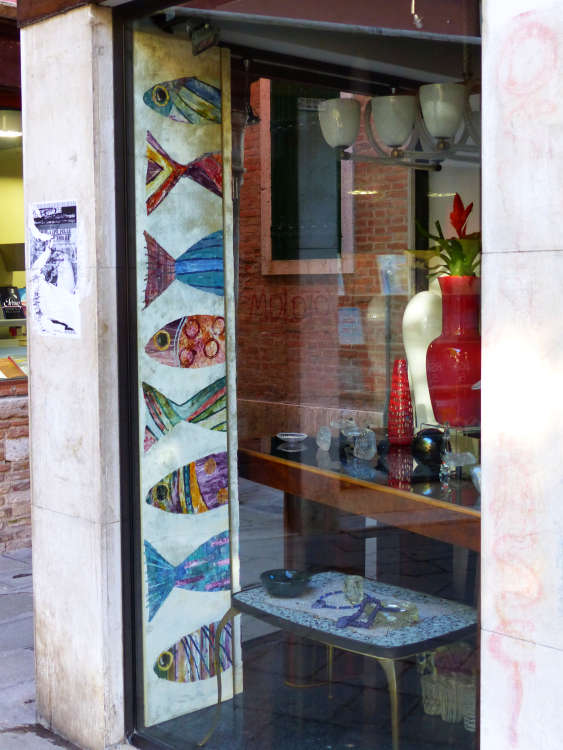 Shop with fish graphics around display window.