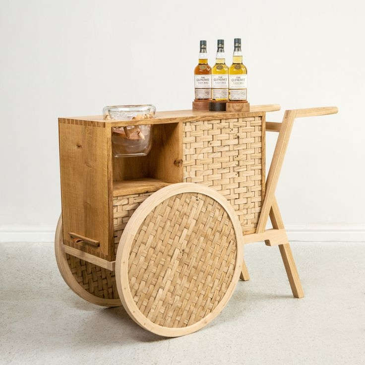A drinks cart inspired by traditional whiskey making process