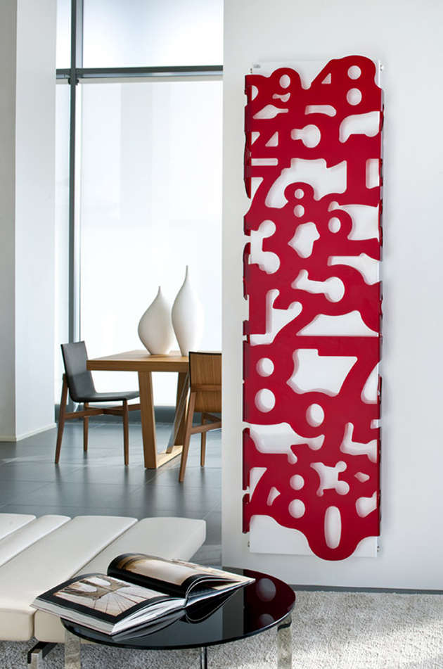 Wall radiator panel with a red plexiglass cover of numerals