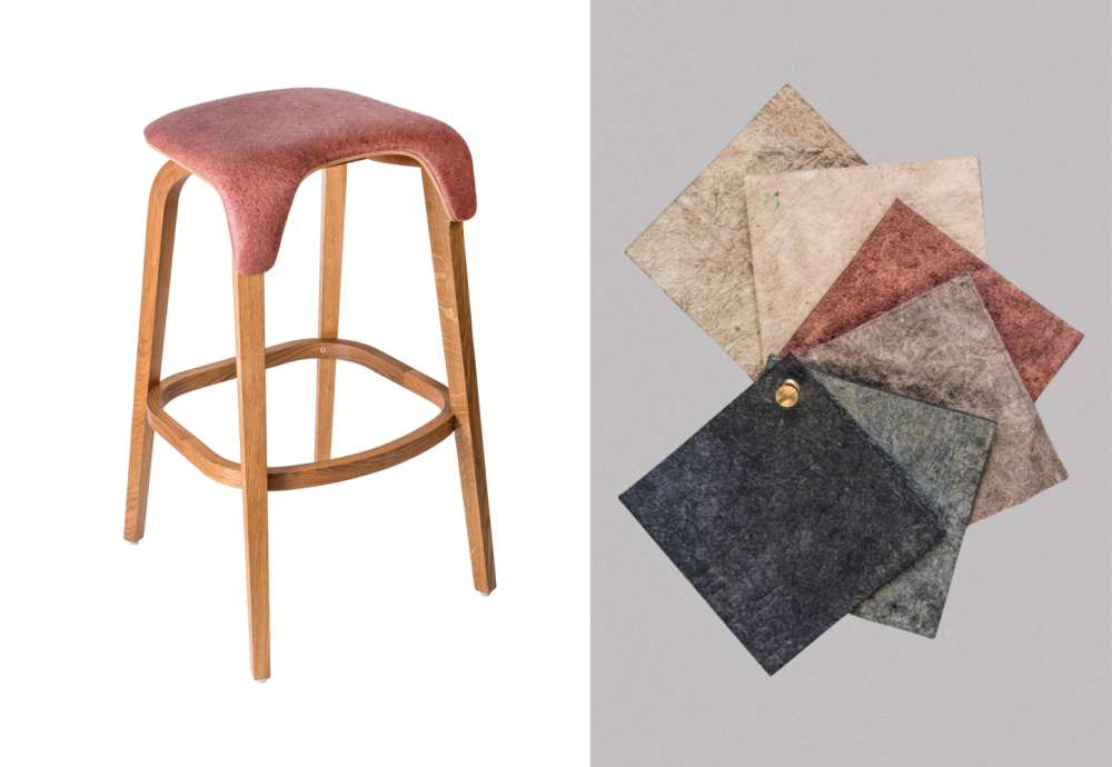 Bar stool upholstered in vegan leather made from recycling industrial waste next to a set of swatches of the material