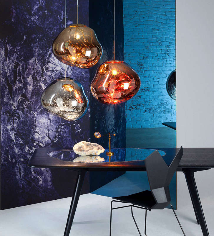 Pendant fixtures that are highly reflective and globular in shape.