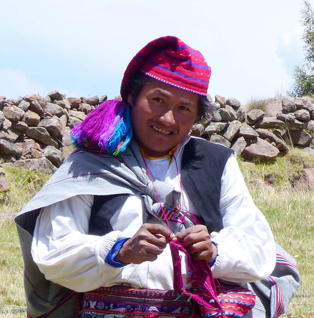 Taquile man knitting