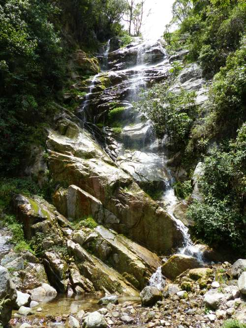 Refreshing waterfall by Wiñay Wayna