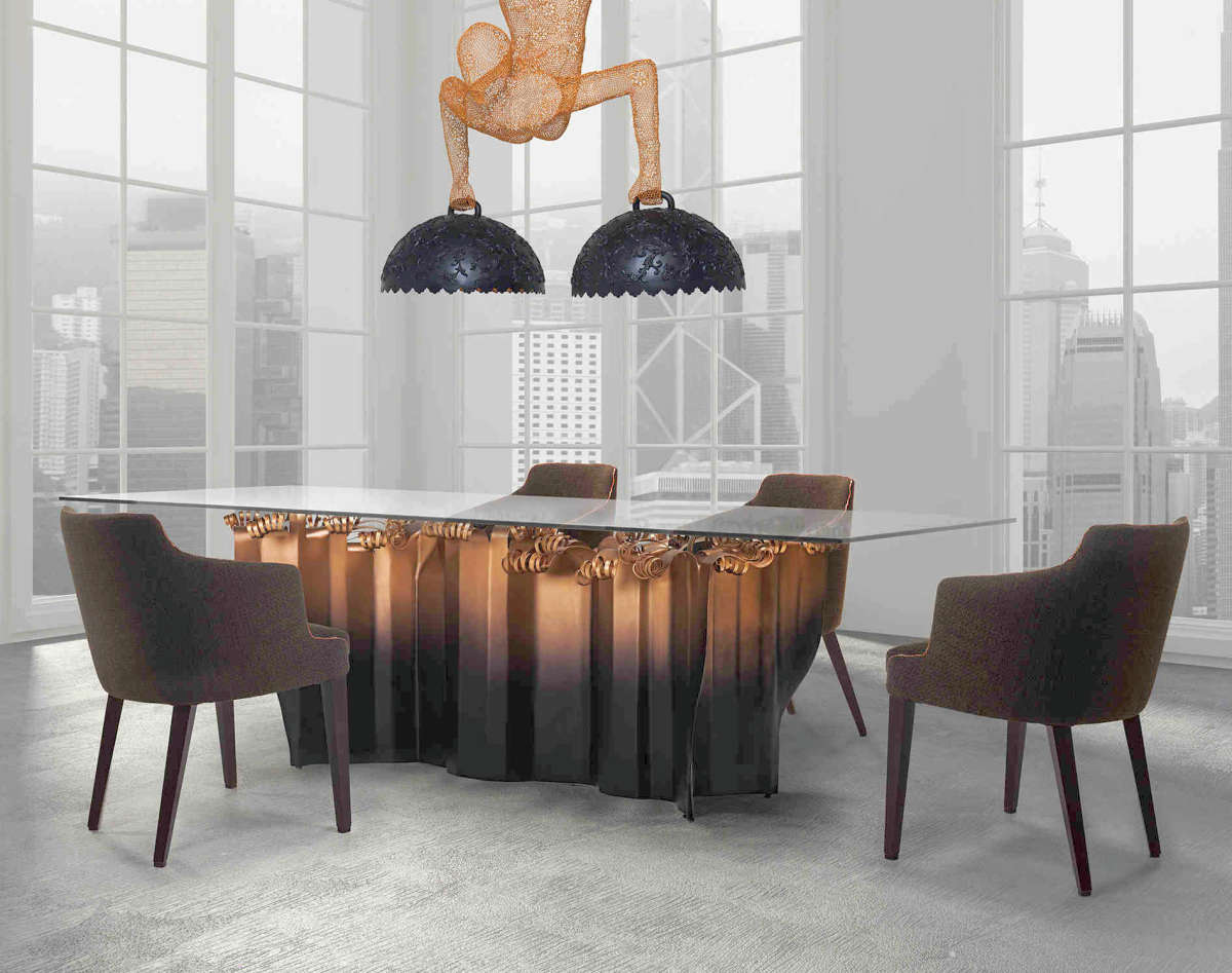 Glass dining table with base of copper columns topped with large coils