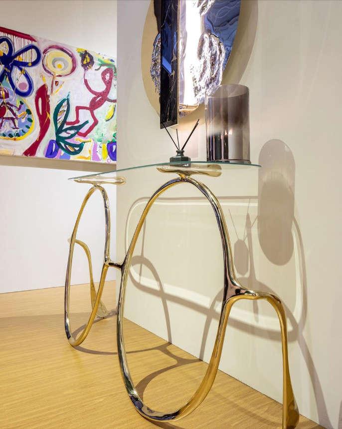 Console table resembling John Lennon's round glasses